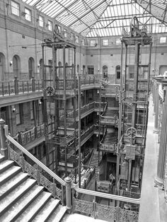 """Interior court of the Bradbury Building in downtown Los Angeles - George Wyman - 1893 """"Blade Runner"""" 306 notes Blade Runner, Bradbury Building, Los Angeles Hollywood, Downtown Los Angeles, Architecture Details, Industrial Architecture, Old Pictures, Stairways, Images"""