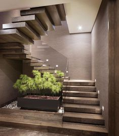 Love the Zen feel of the floating steps around the square planter. Soft taupe & green complemented by recessed lighting & plexi railing Home Stairs Design, Interior Stairs, Modern House Design, Home Interior Design, Exterior Design, Stairs And Staircase, House Stairs, Stairs Architecture, Architecture Design