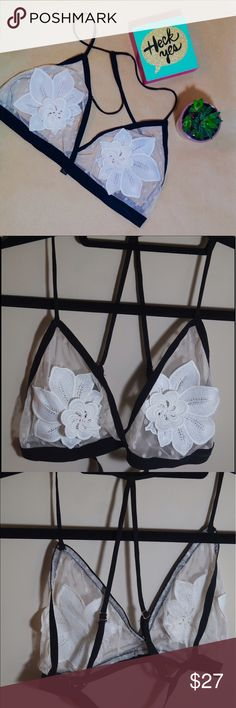 Aakaa Bralette Beautiful polka dot, creme colored mesh bralette with white flower appliqués. Black elastic & trim with adjustable cross straps in the back. Only tried it on, never worn. **Measurements upon request** Aakaa Intimates & Sleepwear Bras
