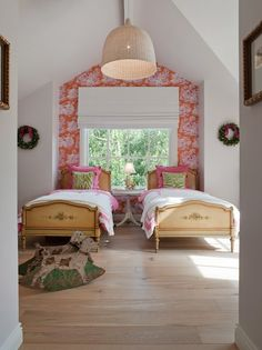 twin beds with one wallpapered wall