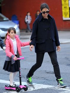 Suri Cruise scooters to school!