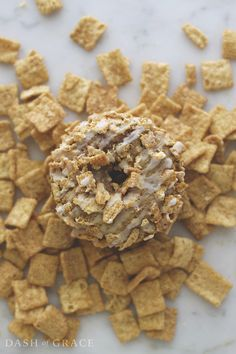 """Cinnamon Toast Crunch Donuts Recipe - These donuts are baked not fried, which basically makes them a health food (wink, wink). The whole grain cereal is baked right on top adding the perfect """"crunch"""" to every bite. And don't forget about the milk! These babies have a creamy, smooth, milk drizzle. The ultimate finishing touch. (dashofgrace.com) @genmills @stellerstories"""