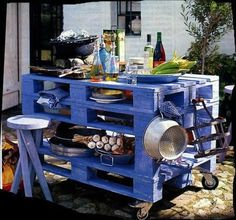 What a clever cooking island for inside or out. Made of pallets.