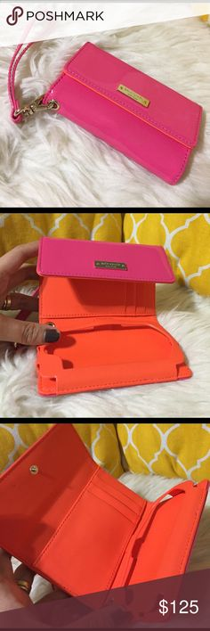 "🌸OFFERS?🌸Kate Spade LeatherWristlet/Phone Holder 💕Authentic💕Excellent shape. Minimal sign of use. Orange interior with 3 card slots, one cash slot, gold hardware and phone slot. Comes with wristlet holder. Patent leather so its water proof. Don't be shy to make an offer💕 Dimensions: 5""x3"" kate spade Bags Clutches & Wristlets"