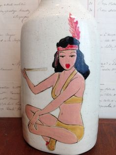 Peace pipe ''GIRLY'' series BY JESSIE LAZAR.  Ceramic bottle. Jessie's girls are reminiscent of vintage tattoos and full of personality.  They are  hand painted and signed.