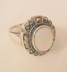 Always something exciting in store many items on sale from 10 to 60% off Beautiful Sterling marcasite Mother of pearl ring size 7