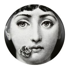 This Tema e Variazioni wall plate is a truly unique piece of art from the world famous Fornasetti brand. Beautifully crafted from porcelain it depicts the face of opera singer Lina Cavalieri holdin...