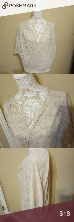 Cream Wrap Top NWOT size Medium Adorable Heathered Cream Wrap Top NWOT size Medium. Batwing sleeves, slight hi/lo hem, and pleating at the shoulders. Lightweight with stretch.  Never worn didn't fit me as I had hoped. Le Lis Tops