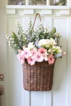 Spring Front Door - Flowers in a hanging basket from @theinspiredroom