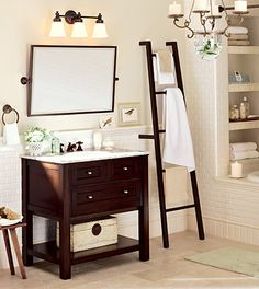 My dream bathroom! I love the use of a ladder as a place to hang towels to dry.