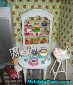 Mandatory Credit: Photo by Michael Williams/MyLifeInPlastic.com  Mattel vintage and collectible Barbie Ken Midge Skipper Alan fashion dolls Fashion Royalty Poppy Parker Misaki FR Nippon dioramas dollhouse scenes cabinets - these are my cabinets from June 2010 in my former Park Slope, Brooklyn, apartment.