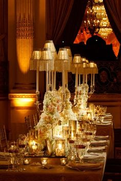 Gorgeous tablescape with the ivory and gold. Especially love the lamp candelabra centerpieces for the lighting.