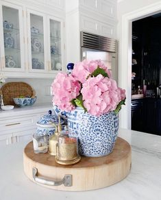 kitchen island with a styled vignette and flowers