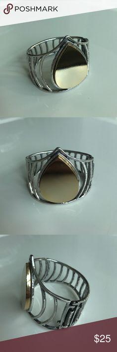 Robert Lee Morris Soho bracelet Robert Lee Morris Soho bracelet. Silver tone metal with gold tone tear drop shape. Hinge closure. Brand new, never worn. Robert Lee Morris Jewelry Bracelets
