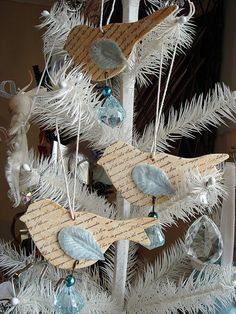 bird ornaments look like they're made from Tim Holtz die.  Could be great Christmas Tree deco's with a bit of Glitter!