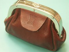 Vintage 1960s small SWEDISH unused traditional style dark vinered real leather exchange purse for money or all thoose small things. $19.50, via Etsy.