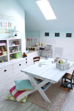 darling playroom.  Love the refinished picnic table and the use of bright colors.