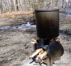 QiWiz Firely UL Titanium Collapsible Wood Stove with an Titanium Pot - http://sectionhiker.com