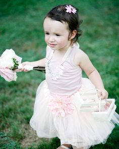 A beaded necklace and ballet flats accessorized this tiny tot's dress