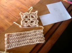 the flat pattern and components for a cup of a crochet motif bra... the flat paper pattern is flipped over for the opposite side