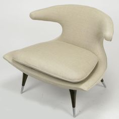 "Karpen Of California Horn Lounge Chair In Natural Linen | Karpen of California 1950s modern ""horn"" lounge chair reupholstered in natural unbleached linen. Tapered walnut legs with brushed steel sabots; loose seat cushion, retains the original label."