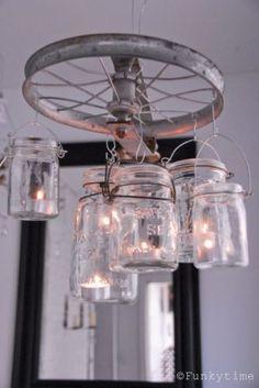 Lamp van wiel en potjes