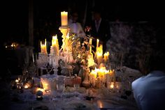 As the sun set, candlelight served as the primary light source, illuminating the dinner tables and adding to the cozy...