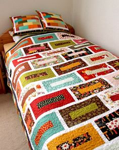 Especially like the pillows. brick wall quilt finished