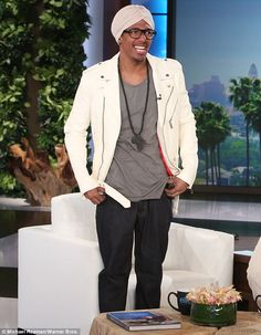 Fashion choice: Nick Cannon talked about wearing a turban during an appearance on The Ellen DeGeneres Show airing on Monday Nick Cannon Turban, Ellen Degeneres Show, The Ellen Show, Mariah Carey, Bandanas, Photo Wall, Therapy, Community, Blazer