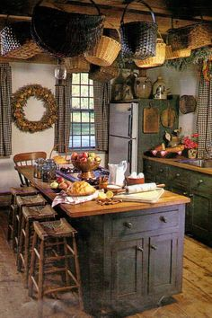 Country kitchen. not so much on the baskets from the ceiling.