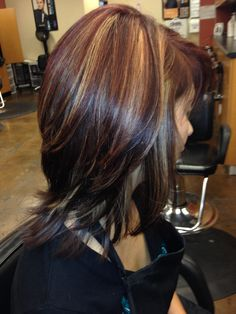 Deep red with caramel blonde hilights