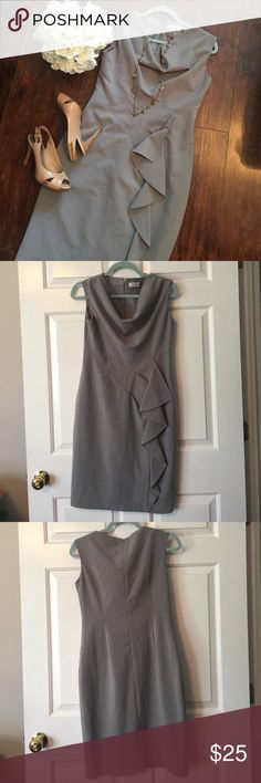 Grey Calvin Klein Dress Very Nice Dress for work... It says it's a size 6 but it fits more like a four!!!. In great condition!!! 37 inches Lind and 15 1/2 inches inches and 15 inches in waist. Calvin Klein Dresses