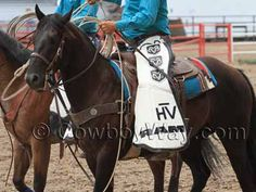 A cowboy wearing batwing chaps