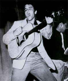 Elvis on stage in Fort Homer ( Florida ) in july 31, 1955.  It's from that show that the cover of his up-coming first L-P ( 1956 )  was taken .