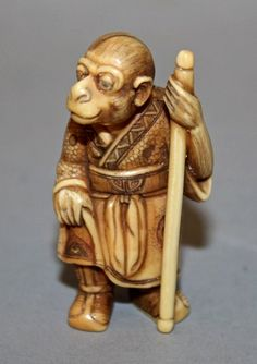 Antique Ivory Netsuke of Songoku the Monkey King on his travels to India to retrive some Sutras on Budha's behalf (in his right hand?). He is in a Budhist Robe and carries his Magical Staff. He is very wise and has great intelligence and cunning. Signed. Now in my collection.