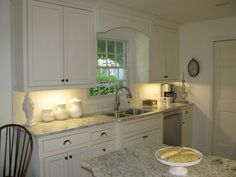 White kitchen with White Galaxy granited counter tops from Hazardous Design: A Real Life Kitchen Makeover