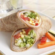 "Turkey, Corn & Sun-Dried Tomato Wraps ㋛  1 cup fresh or frozen (thawed) corn kernels, ½ cup chopped fresh tomato,  ¼ cup chopped soft sun-dried tomatoes, 2 TBsp canola oil, 1 TBsp red-wine vinegar or cider vinegar, 8 thin slices low-sodium deli turkey (~8 oz), 4 (8"") whole-wheat tortillas, 2 cups chopped romaine lettuce"