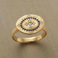Adel Chefridi: Layla ring. This diamond and sapphire cartouche ring is a nod to the forms and technique of ancient mosaics. Adel Chefridi inlays sparkling diamonds and midnight blue sapphires within a cartouche of brushed 18kt gold. (US $2,990)