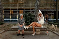 2016 AP YEAR END PHOTOS - A woman looks across as a gay parade participant poses for pictures during Gay Pride parade in Madrid, Spain, July 2, 2016. Photo: Daniel Ochoa De Olza, AP / Copyright 2016 The Associated Press. All rights reserved. This material may not be published, broadcast, rewritten or redistribu