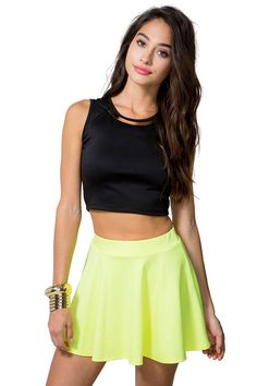 Light it up! A fluorescent and flirty solid ponte knit skater skirt featuring an elasticized waist and a short hem. Looks oh-so-hot with a crop top and strappy sandals!