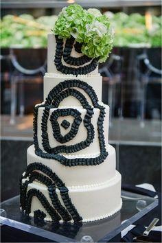 Whimsical black and white wedding cake: http://www.stylemepretty.com/north-carolina-weddings/charlotte/2015/01/29/whimsical-black-and-green-winter-wedding/ | Photography: Smitten & Hooked - http://smittenandhooked.com/