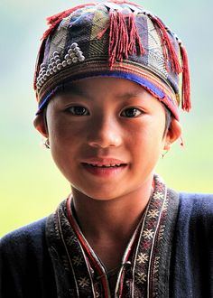 A child of the Red Dzao hill tribe in Ta Phin, near Sapa, Vietnam.