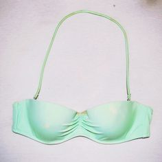 Victoria's Secret Mint Green Swimsuit Top -32B Light Green Swimsuit Top from Victoria Secret. Has built in padding and underwire with a detachable strap that hooks onto top. Stain in the attached middle part is just foundation, I can easily wash it off before sending it to you, just let me know! Victoria's Secret Swim Bikinis