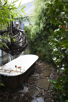 On the back side of the Coaching Cottage is a fully plumbed outdoor bathtub that the family uses frequently.