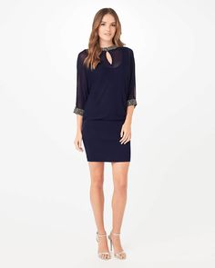 This understated embellished dress oozes style. From Phase Eight