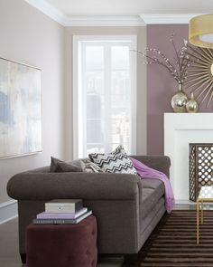purple wall, grey settee, white coving, off-white ceiling