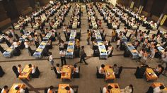 Children participate in a mass contest of Baduk, the Korean version of the Chinese board game Go, in Seoul