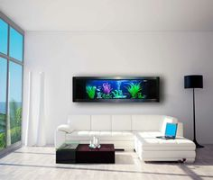 salon blanc avec un canapé blanc, table basse en bois sombre et un aquarium maison de design rectangulaire