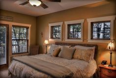 Love the windows above the bed and the patio door/windows leading to a balcony!
