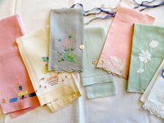 """"""" I found the bright pink tea towel on the left.  I decided to get my little collection out and photograph all of them. I really like the shadow work and using bits of fabric for applique. """""""